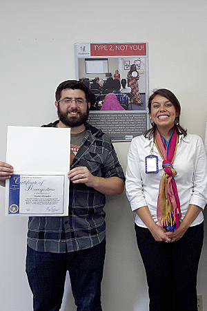 Photo of Kimberly Castillo and college intern Dustin Draughn receiving a certificate of recognition from San Diego Mayor Kevin Falconer