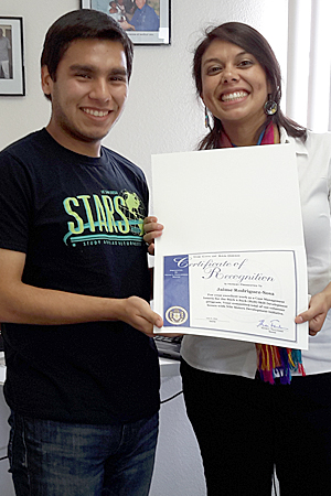 Photo of Kimberly Castillo and college intern Jaime Rodriguez-Sosa receiving a certificate of recognition from San Diego Mayor Kevin Falconer