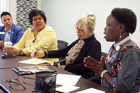 Photo of Elizabeth Lou speaking at a community meeting