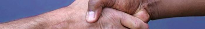Handshake Between an African Man and a Caucasian Man