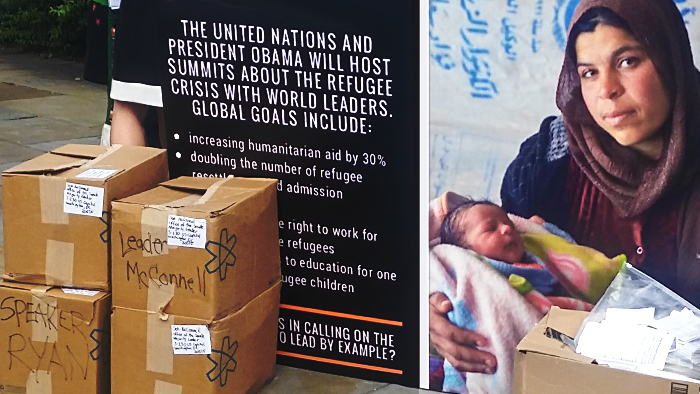 Photo of enlarged refugee postcard displayed outside on the sidewalk