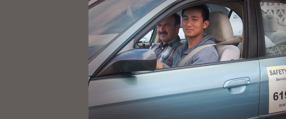 Driver's Education Trainee and His Instructor