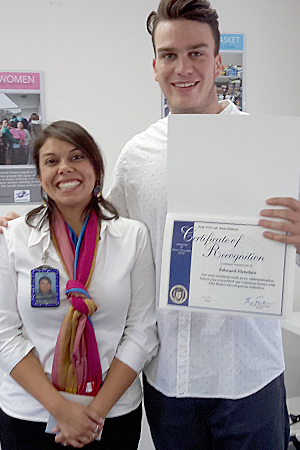 Photo of Kimberly Castillo and college intern Edward Fletcher receiving a certificate of recognition from San Diego Mayor Kevin Falconer