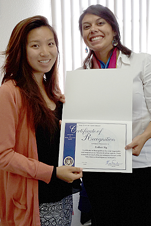 Photo of Kimberly Castillo and college intern Esther Ng receiving a certificate of recognition from San Diego Mayor Kevin Falconer