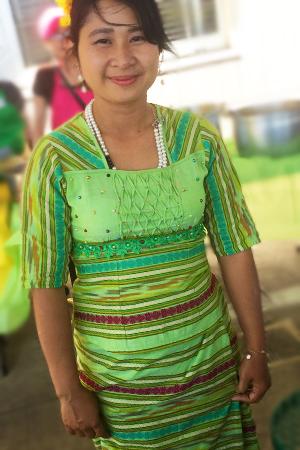 Burmese woman in festive bright green Thingyan attire