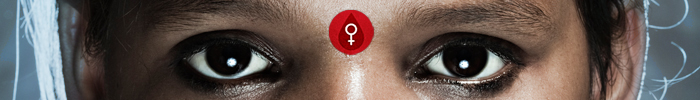 Photo of an East Indian girl's eyes with a female genital cutting icon between her eyebrows.