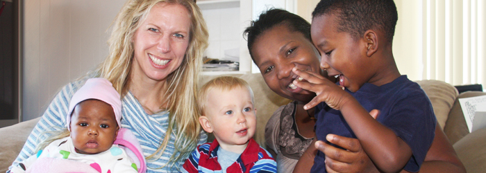 A Young African Mother and Her Preschool Son and Infant Daughter with a Young Caucasian Mother and Her Toddler Son